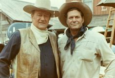 "John Wayne and stunt double Chuck Roberson. In 1949, working as a bit player on John Wayne's ""Fighting Kentuckian"", Chuck had a chance to double for Wayne, already the biggest star on the Republic lot. A tricky mount Chuck performed so impressed Duke that Chuck became Wayne's double for the next 30 years, traveling all over the world with the star and becoming one of his closest friends."