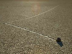 """How do the Sailing Rocks of Racetrack Playa move? 1- A fortunate collision between two of these rocks provided planetary scientist Ralph Lorenz with information. Looking at the trails he observed that one rock had collided against another & been deflected. """" ... it looked like it hit another rock & bounced, but the trail didn't go all the way up to the other rock...,"""" Lorenz told Smithsonian Magazine. What would spontaneously form a barrier around a rock, then disappear? Lorenz realized that"""