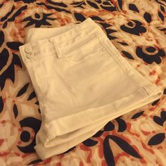 """White Lilly Pulitzer Clifton Shorts Classic cuffed white denim Clifton shorts from Lilly Pulitzer in size 4.  Two very small details to note.  Slight gray smudge on waist band and two slight rust marks on back waistband.  The rust spots are from clips I had hung them to dry.  I'm certain both will come out.  3"""" inseam Lilly Pulitzer Shorts"""