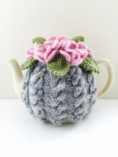 Handmade pure wool cables tea cosy. It's the stylish way to keep your tea hot for longer. https://www.etsy.com/uk/listing/498255180/floral-cabled-tea-cosy-in-pure-wool-size