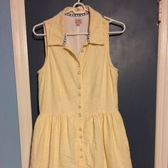 Yellow & White Seersucker Dress w/ Anchor Buttons Yellow and white seersucker Cremieux dress with button front and collar. Almost new. Fully lined. Perfect for a teacher. Sits just at the knee (I'm 5'9). Cremieux Dresses Midi