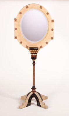 CARLO BUGATTI. A Camelskin, Walnut, Ebonized Wood, Bone, Pewter,and Punched Copper Boudoir Mirror on Stand, circa 1900. 75 ...