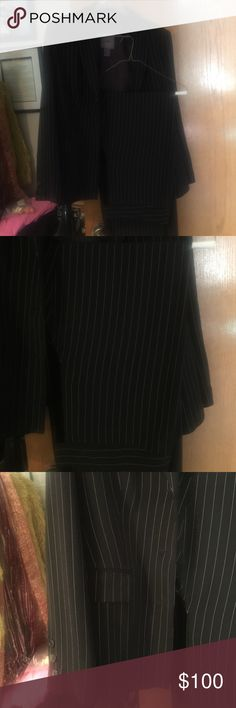 Pantsuit. Awesome condition. Jacket 8 , pants 10. Beautiful pretty much new woman pants suit . It's stripe suite . Jacket have 2 pockets and buttons in sleeves . It's very sharp and was purchased for job interview and never been worn since . Made from polyester and rayon . Pants do not have pockets on the sides or back . Looks good with heels or flats . Very soft and smooth . Brand called Vien vien Pants Trousers
