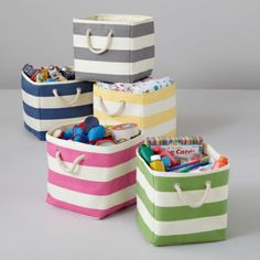 Stripes Around the Cube Bin    LandOfNod Probably going to have to pick up a couple of these in blue for C's room