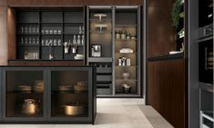 Base cabinets fronts: Heat treated madera oak and black aluminum frame smoked glass Aluminum Kitchen Cabinets, Light Kitchen Cabinets, Aluminium Kitchen, Tall Cabinets, Kitchen Room Design, Kitchen Cabinet Design, Kitchen Designs, Kitchen Ideas, Kitchen Decor