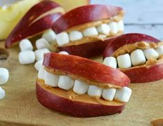 Halloween treat: sliced apples, peanut butter and mini marshmallows