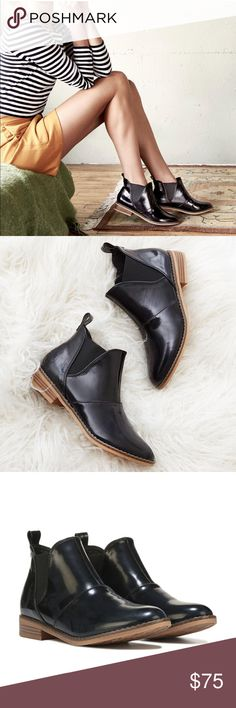 Metallic Black Boxed in Boyfriends Bootie Polish up your act with this super slick black patent  boot. Elastic side feature and back hook for easy slipon and off. Slip On Ankle Boot With Side Elastic On Faux Stacked Heel Synthetic Lining And Footbed Rubber Sole Rocket Dog Shoes Ankle Boots & Booties