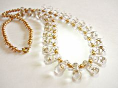 Czech Clear Glass Necklace Pressed Stars Golden by RenaissanceFair...   via pinterest