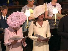 The Duchess of Cambridge, standing next to the Duchess of Cornwall, stunned in a primrose ...