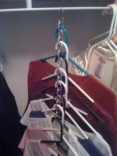 DIY Space-saver hangers. It would be easier to remove things if you instead drilled holes in a strip of wood for the hangers and used a piece of a wire hanger to hang it on the closet rod.