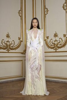 givenchy, spring 2011 (oh my God! The White Lady is wearing this - a gown of spiderwebs and feathers).