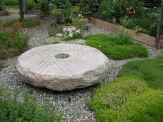 Use a giant millstone as a focal point-- and seating