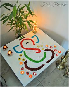 Diwali Décor, Diwali home décor, Diwali Inspiration, easy rangoli design, Ganesha rangoli, Rangoli, Rangoli Designs, rangoli with mirrors, rice rangoli design