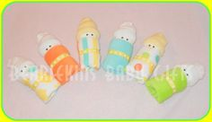 Diaper Babies -- diaper wrapped in a wash cloth, tied with ribbon and topped with a baby sock.