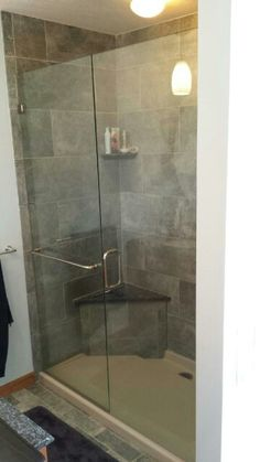 Beautiful 3/8 frameless inline door and panel with minimal hardware and towel bar floating in the fixed panel.  #brittandtilson #asheville #wnc #framelessshowers #custom #shower #bathroom #remodel #glass
