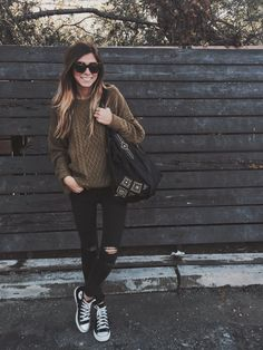 Black distressed skinnies, cute sweater & converse. Classic