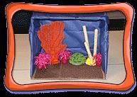 Build your own model coral reef at Howtosmile.org. In the Create a Coral Reef activity from the American Museum of Natural History, make a diorama of a coral reef using craft skills to transform household materials into simulated brain coral, sea fans, sea anemones, and a sponge.