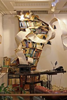 In 'The Secret Lives of Books,' Jena Priebe seeks to make the feeling of books coming alive tangible. Her installation is set in a room, in which thousands of pages will spill out from a single book on an ottoman and swirl toward the ceiling. Pictured, 'Diagnosis' (2012).