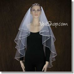 $102.00 Weding Veil:  Center Gathered, fingertip length, Satin Cord edge
