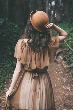 Brown dress and bowler hat outfit