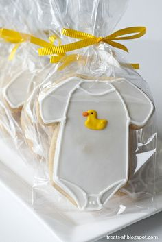 Baby onesie cookies wrapped in cello and curling ribbon. http://www.nashvillewraps.com/cellophane-bags/mc-052.html