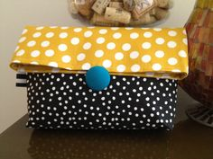 yellow and white, black and white polka dot foldover clutch with button closure