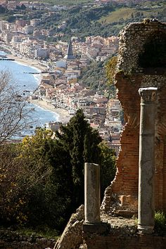 Taormina, Sicily, Italy. Taormina is a comune and small town on the east coast of the island of Sicily, Italy, in the Province of Messina, about midway between Messina and Catania. Taormina has been a very popular tourist destination since the 19th century.