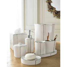 Bath Accessories. Porcelain with Platinum Line. Soap Dish $20. Toothbrush Holder $25. Tumbler $25. Canister $30. Soap Pump $30. Tissue Cover $65. Waste Can $90.
