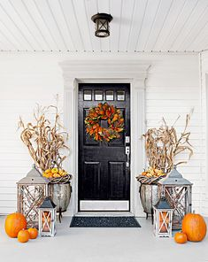 Whether you have a balcony, a wraparound porch, or just a small stoop, you can add seasonal touches to your outdoor space using pumpkins, mums, and more with these fresh fall porch ideas. #fallfrontdoordecor #fallporchdecoratingideas #decorwreathsgarland #outdoordecorideas #bhg