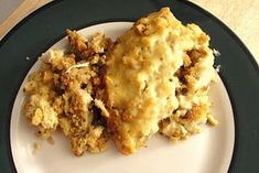 Easy crockpot chicken and stuffing  • 4 chicken breasts  • 6oz. package of Stove Top stuffing mix  • 1/2 cup sour cream  • 1 can of cream of chicken soup  breasts on bottom, then stuffing, mix sour cream , soup, 1/4 cup water together and put over stuffing, 4 hours on low.