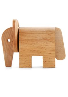 Whether you're working at your desk or sketching in the studio, you could never be lonely with this little companion close by! Crafted from three pieces of solid wood that simply slide together, this adorable elephant 'lumbers' into any habitat to spread happiness as it enchants the imagination. After you introduce yourself and give it a special name, this petite pachyderm is bound to 'dovetail' perfectly with your beloved collection of characters!