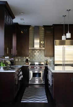 kitchen of blogger/designer Alexandra Berlin...dark cabinets, light countertops and that gorgeous backsplash!