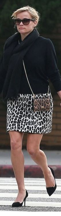 Who made Reese Witherspoon's leopard handbag, animal print skirt, black sunglasses, and black pumps?