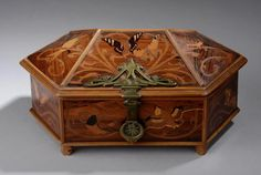 Emile Gallé (1846-1904), Nancy, Mahogany with Fruit Wood Inlays.