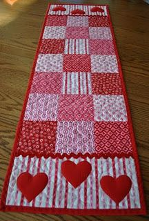 cute Valentines table runner (link goes to a private blog but basically sew 4 or 5 inch squares together, trace out a heart 1/2 inch larger than you want the finished size, add a back and quilt, finish off with rick rack and binding.