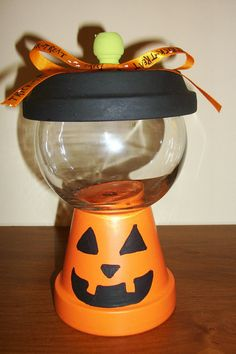 Items similar to Jack O' Lantern Faux Gumball Machine on Etsy Flower Pot Crafts, Clay Pot Crafts, Diy Clay, Flower Pots, Halloween Decorations For Kids, Halloween Crafts, Fall Crafts, Halloween Candy, Kid Crafts