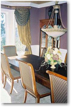 Another view of this formal dining room with contrasting fabrics, and matching trim and tiebacks.