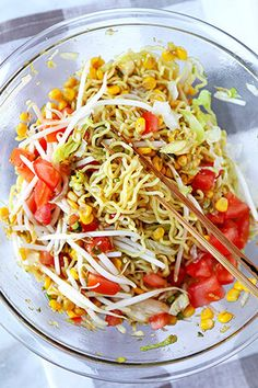 A quick & delicious Chilled Ramen Noodle Salad tossed with fresh tomatoes, corn, lettuce, eggs & bean sprout, with a sweet vinegar & sesame dressing.