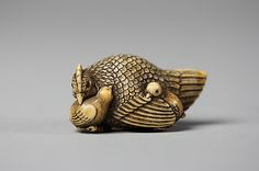 Netsuke of Hen and Two Small Chicks, 18th-19th century. Japan.