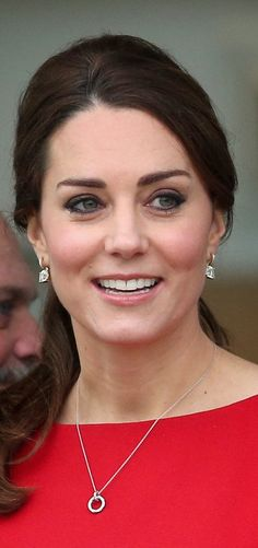 Kate accessorized with dainty regal jewels.