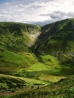 The Devil's Beef Tub , Scotland ~ The Devil's Beef Tub, is a deep, dramatic hollow in the hills north of the Scottish town of Moffat. The 500-foot deep hollow is formed by four hills, Great Hill, Peat Knowe, Annanhead Hill, and Ericstane Hill.