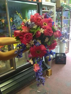 Bridal Bouquets -Cascade with pink gerber daisys, blue delph, fuscia roses and stephonotis.
