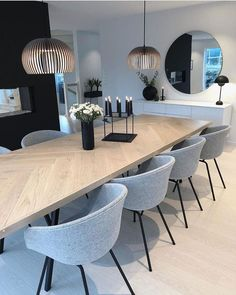 Beautiful modern transitional dining room with white oak flooring, dining table, and grey chairs
