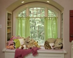 Bookcases built in on each side of the dormer.  DO THIS FOR THE NARROW DORMERS and bench seats