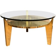 Pair of Brass and Glass Circular Side Tables   From a unique collection of antique and modern coffee and cocktail tables at http://www.1stdibs.com/furniture/tables/coffee-tables-cocktail-tables/