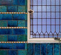 Detail of glazed aquamarine brick and critall window, Holland House, designed by Berlage Hendrick Petrus, London, United Kingdom