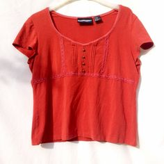Burnt Orange Loose Top Loose deep orange top with faux buttons down front, as well as lace bordering around the chest/bust, also around the neckline. Very stretchy. Can fit sizes medium-xl. Requirements Tops Tees - Short Sleeve