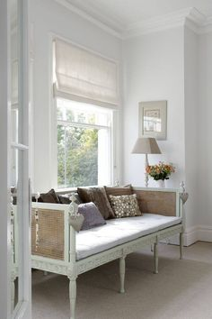 gustavian sofa -- also love the white on white shade.