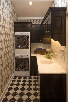 """I want this laundry room!  The dimensions are almost exact.  This room is 70""""x108"""".  My room is 61 1/2""""x108"""".  I'd make a few changes - red appliances, bigger/wider and lower sink for dog washing and mop bucket filling.  Make room for upright freezer.  Longer hanging rod.  Don't like the wall paper. Maybe do board and batten look with hooks for leashes."""