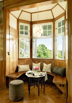Like the rustic bench and ceiling treatment in this little bay window nook.